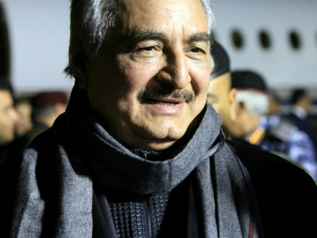 Marshal Khalifa Haftar, the military leader of the so-called Libyan National Army and Libyas parallel parliament based in the eastern city of Tobruk, is greeted upon his arrival at Al-Kharouba airport south of the town of al-Marj, about 80 km east of the Mediterranean port city of Benghazi on December …