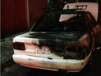 Monterrey burned out car