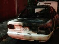 Monterrey burned out car
