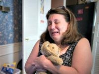 In this Wednesday, Sept. 2, 2015, photo, Dorothy McIntosh Shuemake, mother of Alison Shuemake who died of a suspected heroin overdose, cries as she clutches her daughter's toy stuffed rabbit during an interview at her home, in Middletown, Ohio. The Centers for Disease Control and Prevention has called heroin use …