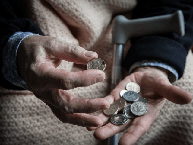 In this photo illustration an elderly person looks at cash at home on February 16, 2015 near Bristol, England. The issues affecting the elderly, along with education and the economy are likely to be key elections issues in the forthcoming general election in May.