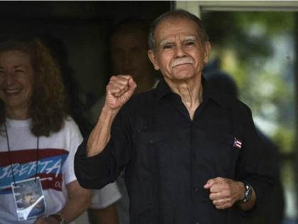 Puerto Rican nationalist Oscar López Rivera gestures as he is released Wednesday from house arrest in San Juan, Puerto Rico, after 36 years in custody.