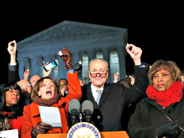 Rep. Sheila Jackson Lee D-Texas, left, House Minority Leader Nancy Pelosi of Calif., Senate Minority Leader Chuck Schumer of New York, Rep. Brenda Lawrence, D-Mich., right, and other members of Congress, hold small candles aloft in front of the Supreme Court during a news conference about President Donald Trump's recent …