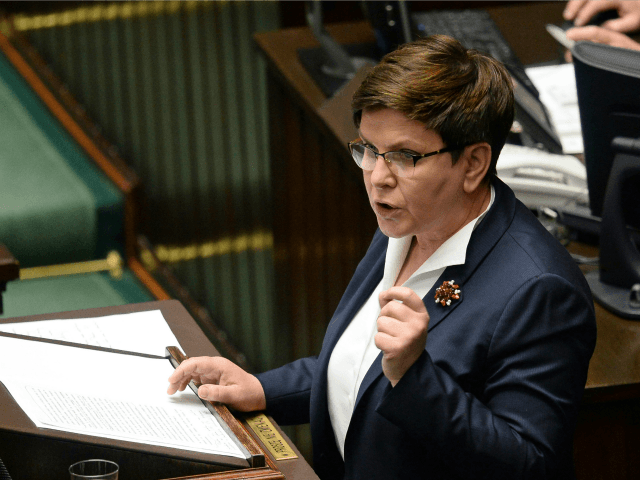 "Polish Prime Minister Beata Szydlo speaks in the Polish parliament during a debate on a vote to dismiss Defense Minister Antoni Macierewicz, in Warsaw, Poland, Wednesday, May 24, 2017. Szydlo said that Poland cannot be blackmailed by ""Brussels elites"" to accept migrants."