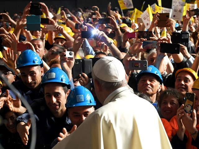 TOPSHOT - Pope Francis is welcomed and photographed upon his arrival for a meeting with workers of the Ilva steel plant as part of a one-day visit in Genoa, on May 27, 2017. / AFP PHOTO / Andreas SOLARO (Photo credit should read ANDREAS SOLARO/AFP/Getty Images)