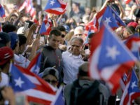 FILE - In this May 18, 2017 file photo, Puerto Rican nationalist Oscar Lopez Rivera, center, who pardoned by former President Barack Obama in January, arrives for a gathering in his honor in Chicago's Humboldt Park neighborhood. Organizers of New York's Puerto Rican Day Parade on June 11 stand firm …