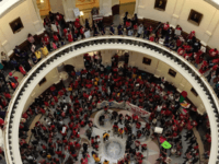 Protesters in Texas Capitol Rotunda about sanctuary city law.