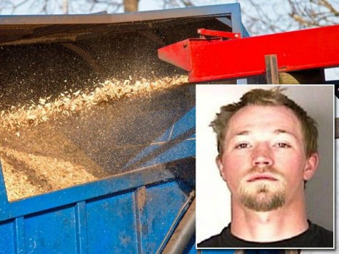 Scott Edward Iverson is accused of trying to shove a coworker into a running wood chipper.