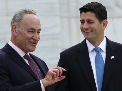 Speaker of the House Paul Ryan (R) (R-WI) and Sen. Chuck Schumer (L) (D-NY) confer during the ÒFirst Nail CeremonyÓ September 21, 2016 outside the U.S. Capitol in Washington, DC. The ceremony marked the official launch of construction on the Inaugural platform where the next President of the United States …
