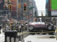 FILE - In this Thursday, May 18, 2017 file photo, a car rests on a security barrier in New York's Times Square after driving through a crowd of pedestrians, injuring at least a dozen people. A three-foot-tall piece of stainless steel in the ground ultimately stopped a speeding Honda Accord …