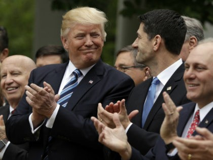 President Donald Trump talks with House Speaker Paul Ryan of Wis., in the Rose Garden of the White House in Washington, Thursday, May 4, 2017, after the House pushed through a health care bill. House Majority Whip Steve Scalise of La. is at left, and House Ways and Means Committee …