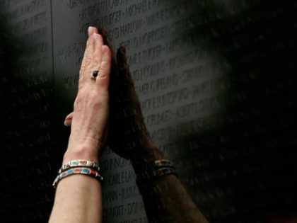 Ann Pruett reaches to touch the name of her husband, Richard Monroe Pruett, which was added to the Vietnam Veterans Memorial May 3, 2007 in Washington, DC. Pruett's husband, Richard Monroe Pruett, who died in 2005 from wounds sustained in Vietnam, was one of three men whose name was added …
