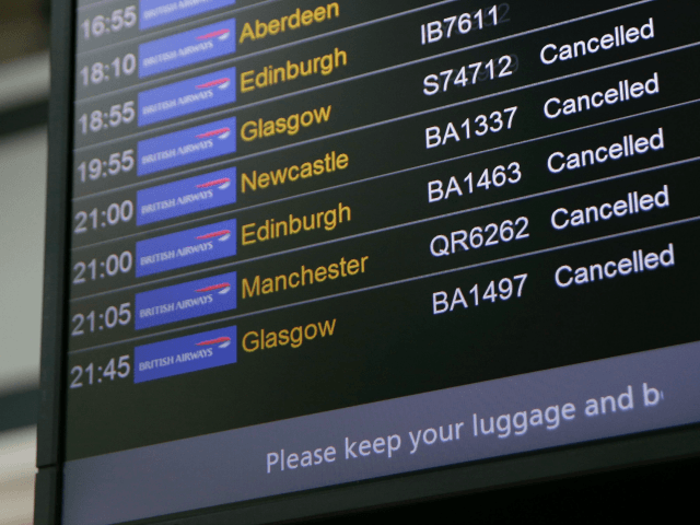 An electronic board shows British Airways flights cancelled at Heathrow Airport Terminal 5 in west London on May 27, 2017.