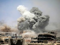 TOPSHOT - Smoke rises from buildings following a reported air strike on a rebel-held area in the southern Syrian city of Daraa, on May 22, 2017. / AFP PHOTO / Mohamad ABAZEED (Photo credit should read MOHAMAD ABAZEED/AFP/Getty Images)