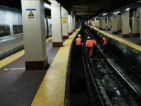NEW YORK, NY - APRIL 26: Track maintenance workers walk along train tracks used by both New Jersey Transit and Amtrak trains at Pennsylvania Station on April 26, 2017 in New York City. Following two recent derailments at the crowded Manhattan station, Amtrak officials are now considering closing tracks at the station for an extended duration to make long-term repairs. Commuters fear that these temporary closings would only add to recent delays and cancellations of trains. (Photo by Spencer Platt/Getty Images)