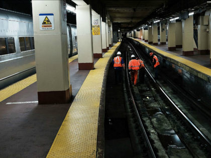 NEW YORK, NY - APRIL 26: Track maintenance workers walk along train tracks used by both New Jersey Transit and Amtrak trains at Pennsylvania Station on April 26, 2017 in New York City. Following two recent derailments at the crowded Manhattan station, Amtrak officials are now considering closing tracks at …