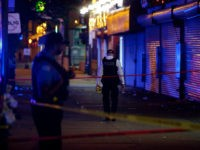 Chicago Police officers stand at the crime scene where a man was shot in the 7100 block of South State Street on May 28, 2017 in Chicago, Illinois. The Chicago Police Department added 1,300 extra officers around the city to patrol the streets for the Memorial holiday weekend. / AFP …