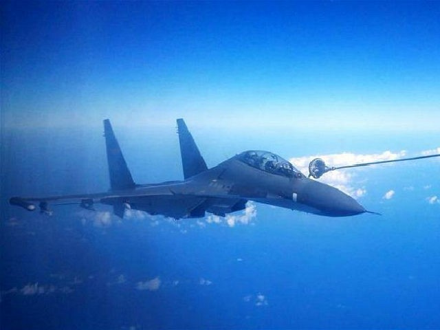 NANJING, Sept. 25, 2016 -- A Su-30 fighter of the Chinese Air Force gets fueled in the air during a drill, Sept. 25, 2016. The Chinese Air Force on Sunday sent more than 40 aircraft of various types to the West Pacific, via the Miyako Strait, for a routine drill on the high seas, a spokesperson said. Bombers and fighters of the PLA Air Force also conducted routine patrol in the East China Sea Air Defense Identification Zone. (Xinhua/Xie Jin via Getty Images)