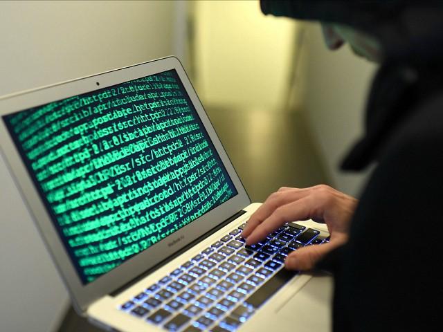 """Illustration of cybercrime (Photo credit should read """"HELMUT FOHRINGER/APA-PictureDesk via AFP"""") Helmut Fohringer / APA-PictureDesk / APA"""