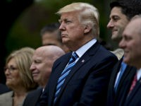 U.S. President Donald Trump, center, listens during a press conference in the Rose Garden of the White House in Washington, D.C., U.S., on Thursday, May 4, 2017. House Republicans mustered just enough votes to pass their health-care bill Thursday, salvaging what at times appeared to be a doomed mission to …