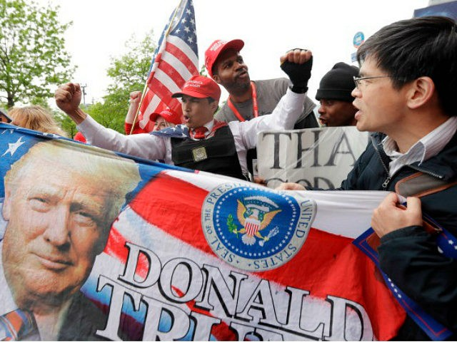 Supporters of President Donald Trump chant as they gather near the Intrepid Sea, Air & Space Museum, where Trump is expected to attend the 75th Anniversary Battle of the Coral Sea Commemorative Dinner on the USS intrepid, Thursday, May 4, 2017, in New York. (AP Photo/Julio Cortez)