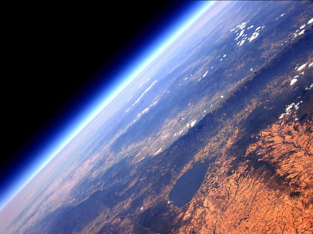 SUB-ORBITAL SPACE - JULY 19: Tropospheric (lowest point in the atmosphere) point of view of Lake Doirani 15000 metres above earth, on July 19, 2012 in Sub-Orbital Space. A GREEK engineer has built his own high altitude balloons capable of photographing earth at the stratospheric layer - five times higher …