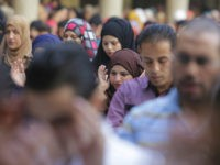 Egyptian women pray Eid al-Fitr prayers, marking the end of the Muslim holy fasting month of Ramadan at Al-Azhar mosque, the highest Islamic Sunni institution, in Cairo, Egypt, Monday, July 28, 2014. (AP Photo/Amr Nabil)