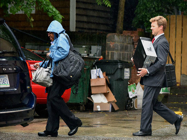 Federal agents exit the back of an office building after the FBI served a search warrant at the office of Strategic Campaign Group on Thursday, May 11, 2017, in Annapolis, Md. (MATTHEW COLE/THE BALTIMORE SUN VIA AP)