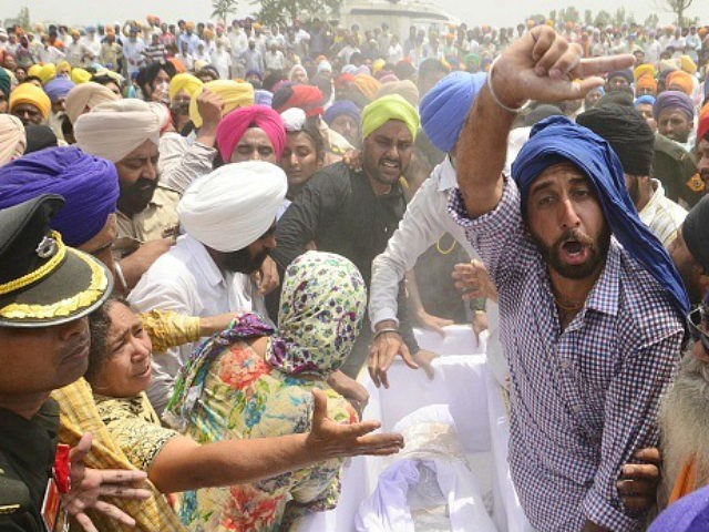 AMRITSAR, INDIA - MAY 2: Relatives and Residents during cremation of martyr Indian army soldier Paramjit Singh at Vein Pein village, some 45 km from Amritsar, on May 1, 2017 in Amritsar, India. Pakistani forces killed two Indian soldiers Paramjit Singh, Naib Subedar and mutilated their bodies along the Line …