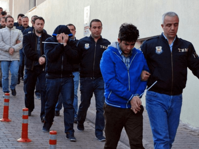 Police officers escort people, arrested because of suspected links to U.S.-based cleric Fethullah Gulen, in Kayseri, Turkey, Wednesday, April 26, 2017. Police launched simultaneous operations across the country on Wednesday, detaining hundreds of people with suspected links to U.S.-based cleric Fethullah Gulen. The suspects are allegedly Gulen operatives who directed …