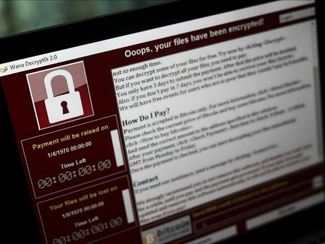 A lock screen from a cyber attack warns that data files have been encrypted on a laptop computer in this arranged photo in London, U.K., on Monday, May 15, 2017. Governments and companies around the world began to gain the upper hand against the first wave of an unrivaled global …