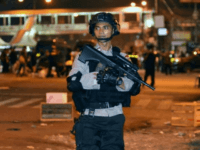 Indonesia's elite anti-terror squad was Thursday investigating a suicide bombing attack near a busy Jakarta bus station that killed three policemen.
