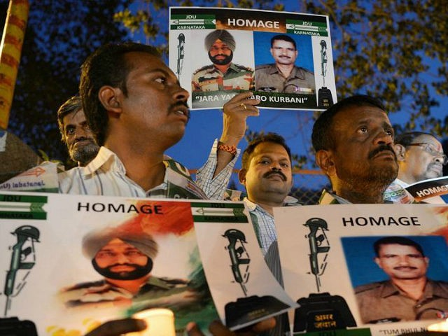 Indian activists stage a candlelight vigil in Bangalore on May 4, 2017, to condemn recent allegations of the mutilation of Indian soldiers' bodies by Pakistani soldiers in the disputed region of Kashmir. The Indian army accused Pakistan on May 1, of killing two of its soldiers and mutilating their bodies …