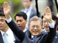 South Korea's new President Moon Jae-in waves to neighborhoods and supporters upon his arrival at outside of the presidential Blue House in Seoul, South Korea, Wednesday, May 10, 2017. New South Korean President Moon Jae-in said Wednesday he was open to visiting rival North Korea under the right conditions to talk about Pyongyang's aggressive pursuit of nuclear-tipped missiles. (AP Photo/Lee Jin-man)