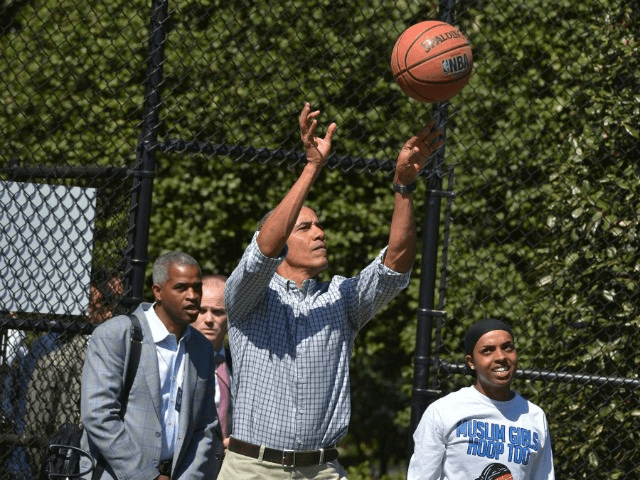 Then-US President Barack Obama takes a shot while playing basketball during the annual Easter Egg Roll on the South Lawn of the White House on April 6, 2015 in Washington, DC