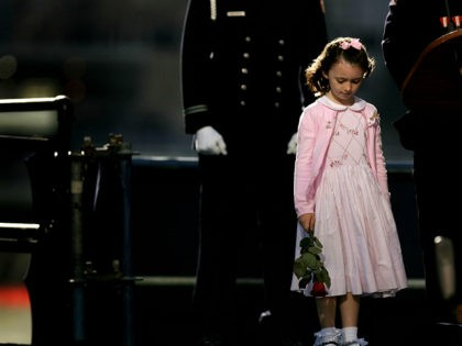 Patricia Smith, the daughter of police officer Moira Smith who was killed five years ago, pauses during a ceremony Monday, Sept. 11, 2006 at the World Trade Center in New York marking the fifth anniversary of the terrorist attacks. (AP Photo/Spencer Platt, Pool)