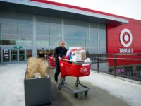 Shoppers exit a Target Corp. store with their shopping carts n Toronto, Ontario, Canada, on Thursday, Jan. 15, 2015. Target Corp. will walk away from Canada less than two years after opening stores there, putting an end to a mismanaged expansion that racked up billions in losses. Photographer: Kevin Van …