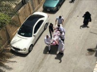 "This image provided by an activist who requested to remain unnamed, shows people carrying a man who was injured in a raid on an sit-in, in Diraz, Bahrain, Tuesday, May 23, 2017. Bahrain police raided a town where the sit-in has been going on for months in support of Sheikh Isa Qassim, a prominent Shiite cleric, who had his citizenship stripped by the government. An activist said one protester was killed. Bahrain's Interior Ministry said on Twitter Tuesday that the operation targeting Diraz was to ""maintain security and public order."" (AP Photo)"
