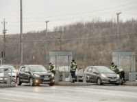 MALMO, SWEDEN - FEBRUARY 06: Swedish police officers check driver's IDs at the Oresund bridge on February 5, 2016 in Malmo, Sweden. ID checks on the border with Denmark has been set up by the Swedish government since January 4. Last year Sweden received 162,877 asylum applications, more than any …
