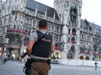 A policeman stands guard at the Marienplatz square in Munich, southern Germany, on July 22, 2016, after a deadly attack at the Olympia-Einkaufszentrum shopping centre in the Bavarian capital. Police were probing the motives of the lone teenage German-Iranian gunman who went on a deadly rampage at a busy Munich …