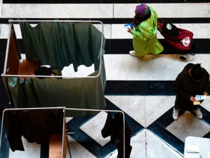 People arrive to vote at a polling station in Marseille, southern France on May 7, 2017 during the second round of the French presidential election. / AFP PHOTO / ANNE-CHRISTINE POUJOULAT (Photo credit should read ANNE-CHRISTINE POUJOULAT/AFP/Getty Images)