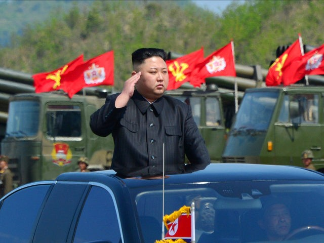 This undated picture released by North Korea's official Korean Central News Agency (KCNA) on April 26, 2017 shows North Korean leader Kim Jong-Un (C) attending the combined fire demonstration of the services of the Korean People's Army in celebration of its 85th founding anniversary at the airport of eastern front. …