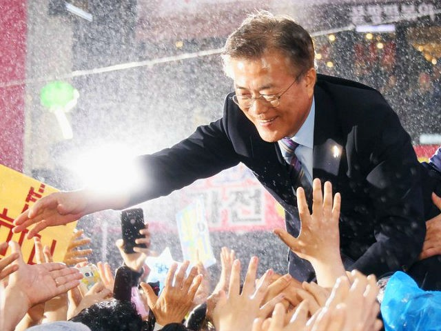 File photo taken May 5, 2017, shows Moon Jae In of the liberal Democratic Party of Korea greeting supporters in the rain in Busan during campaigning in South Korea's presidential election. Voting concluded on May 9. (Kyodo) ==Kyodo (Photo by Kyodo News via Getty Images)