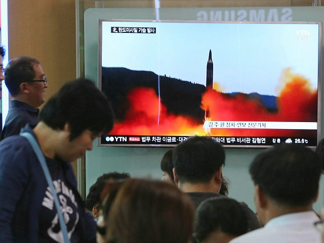 People watch a TV news program showing a file image of a missile launch by North Korea, at the Seoul Railway Station in Seoul, South Korea, Sunday, May 21, 2017. North Korea on Sunday fired a midrange ballistic missile, U.S. and South Korean officials said, in the latest weapons test …