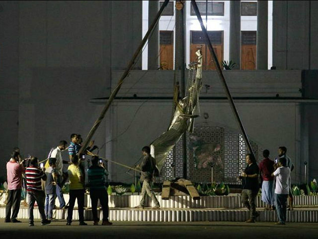 Bangladeshi workers take down a controversial statue on the premises of the country's highest court after Islamist radicals protested for months against what they called an 'un-Islamic' Greek deity on May 26, 2017. Bangladesh on May 26 removed a controversial statue depicting a goddess of justice outside its Supreme Court …