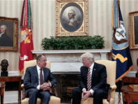 US President Donald Trump, right, meets Russian Foreign Minister Sergey Lavrov at the White House in Washington, Wednesday, May 10, 2017. President Donald Trump on Wednesday welcomed Vladimir Putin's top diplomat to the White House for Trump's highest level face-to-face contact with a Russian government official since he took office in January. (Russian Foreign Ministry Photo via AP)