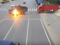 A motorcyclist in China survived a crash Saturday in which his motorcycle burst into flames. He was rescued, thanks to a truck driver's quick thinking.