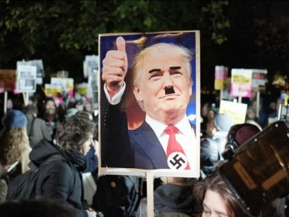 Hundreds of people gather outside the American embassy in London on 9 November 2016 to protest against the election of Donald Trump as president of the US. During the protest two supporters of the far-right EDL showed up to give their support to Trump. (Photo by Jay Shaw Baker/NurPhoto via …