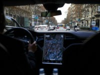 A Tesla Motors Inc. Model S electric automobile, operated Uber Technologies Inc., drives through traffic, in Madrid, Spain, on Friday, Jan. 13, 2017. Ride-hailing service Uber Technologies has launched its first electric car taxi service in Madrid, operating a fleet of Tesla Model S electric vehicles. Photographer: Angel Navarrete/Bloomberg via …