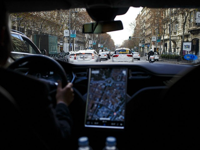 A Tesla Motors Inc. Model S electric automobile, operated Uber Technologies Inc., drives through traffic, in Madrid, Spain, on Friday, Jan. 13, 2017. Ride-hailing service Uber Technologies has launched its first electric car taxi service in Madrid, operating a fleet of Tesla Model S electric vehicles. Photographer: Angel Navarrete/Bloomberg via Getty Images